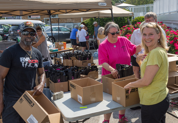 Duck & Wine Festival volunteers arrived early to  set up the event.