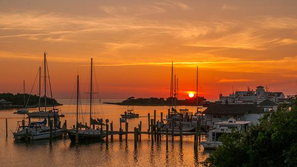The sun sets over Silver Lake harbor, Ocracoke, NC