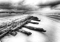 Strong timbers, all that remain of a wooden schooner, Hatteras Beach, NC (B&W)