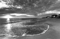 The sun bursts through the clouds in Kitty Hawk (B&W)