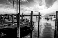 The sun sets over a tranquil Silver Lake harbor, Ocracoke, NC (B&W)